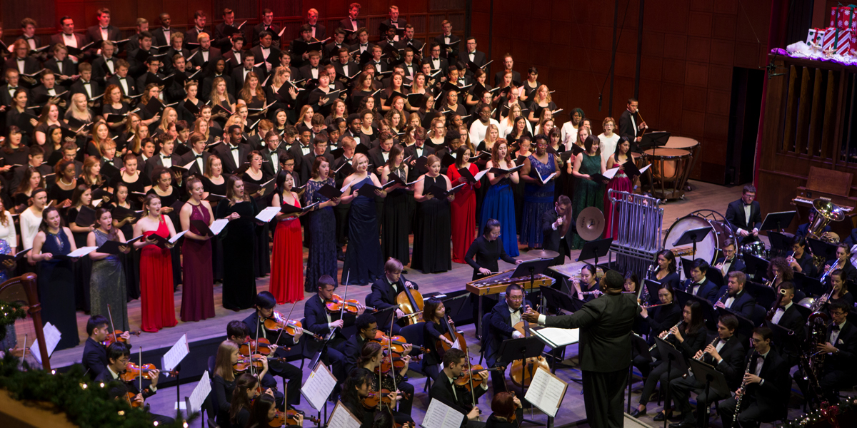 A choir and orchestra perform on stage during CCM's 2017 Feast of Carols. Photo by Andrew Higley.