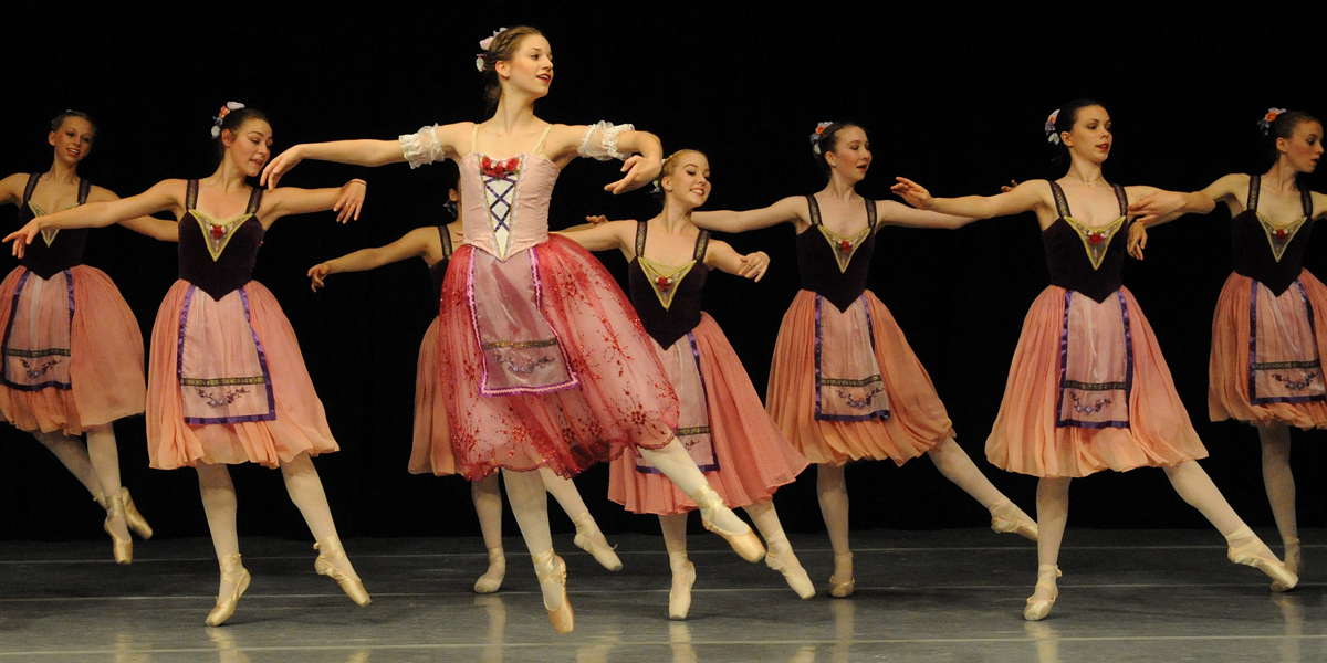 A group of young women dance in a CCM Youth Ballet performance. Photo by Kyuran Ann Choe.