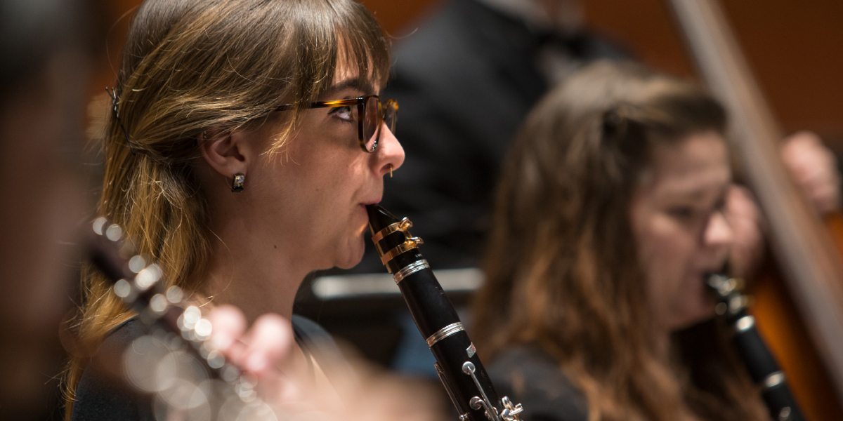 CCM Wind Symphony performs on stage