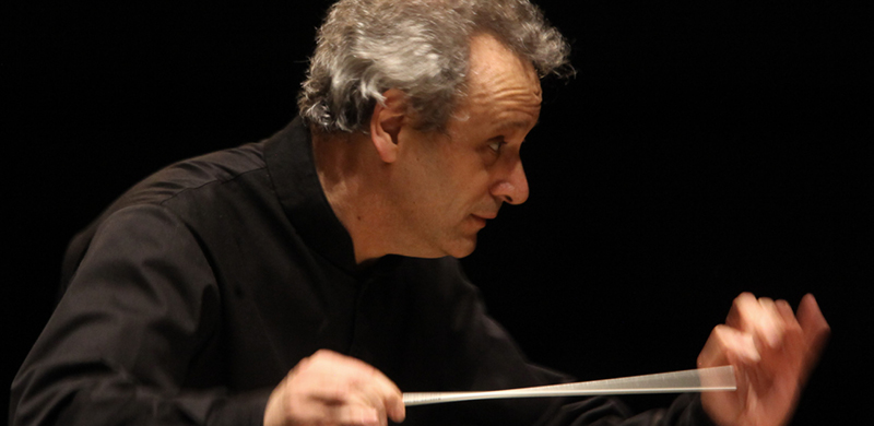 A photograph of Louis Langrée conducting. Photo by Mark Lyons.