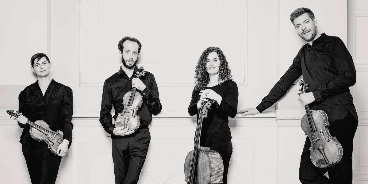 The four members of the Ariel Quartet, string quartet-in-residence at CCM, pose with their musical instruments in a black and white photo by Marco Borggreve.