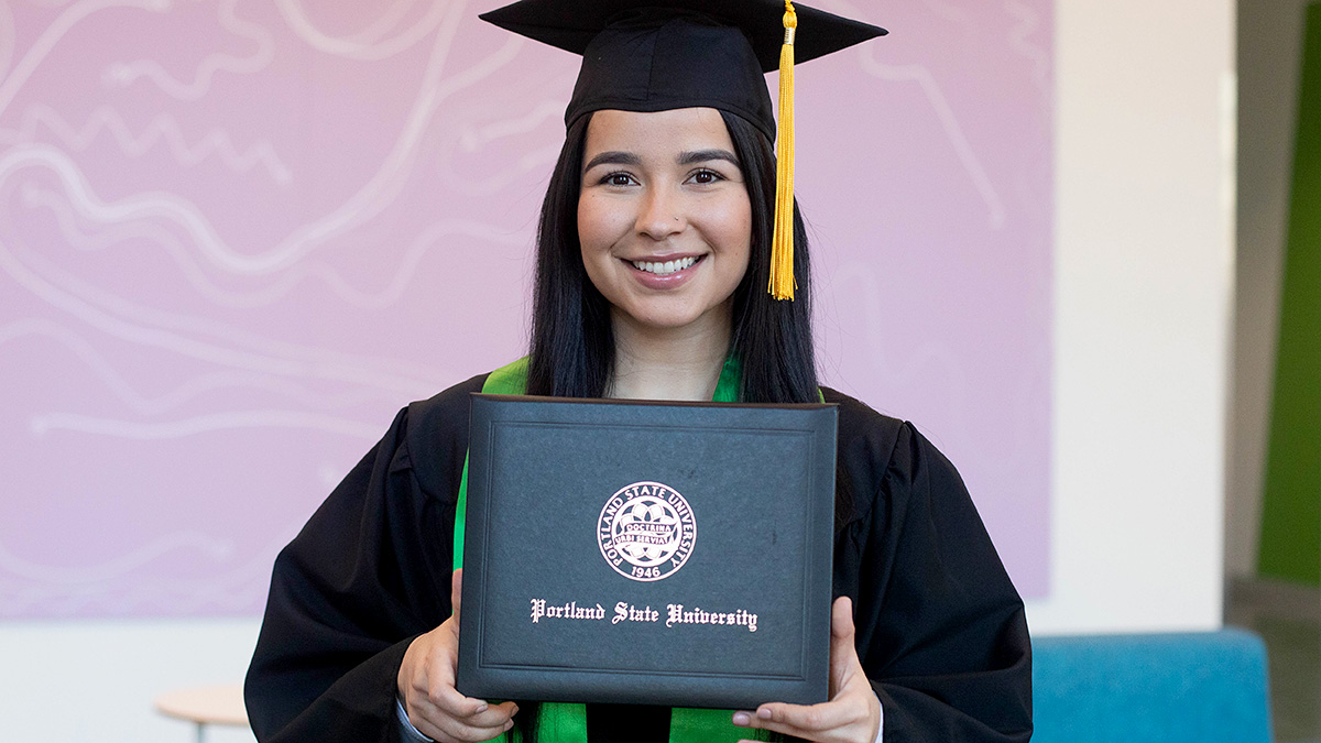 Diploma covers are black with commencement seal and the words Portland State University.