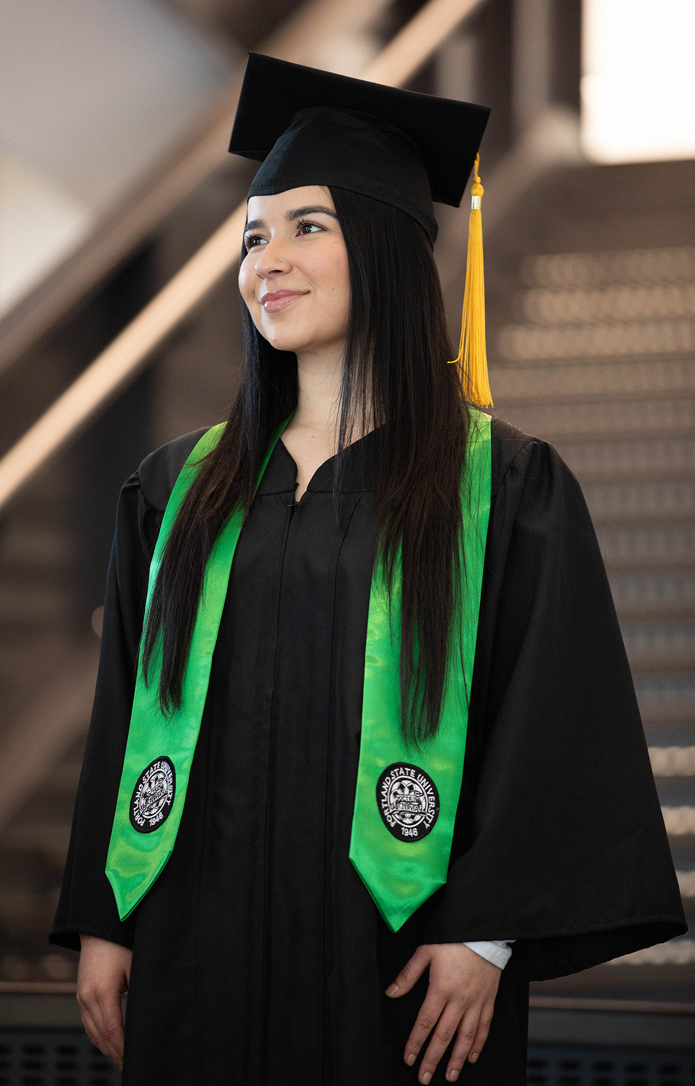Green stole of gratitude with Portland State commencement insignia