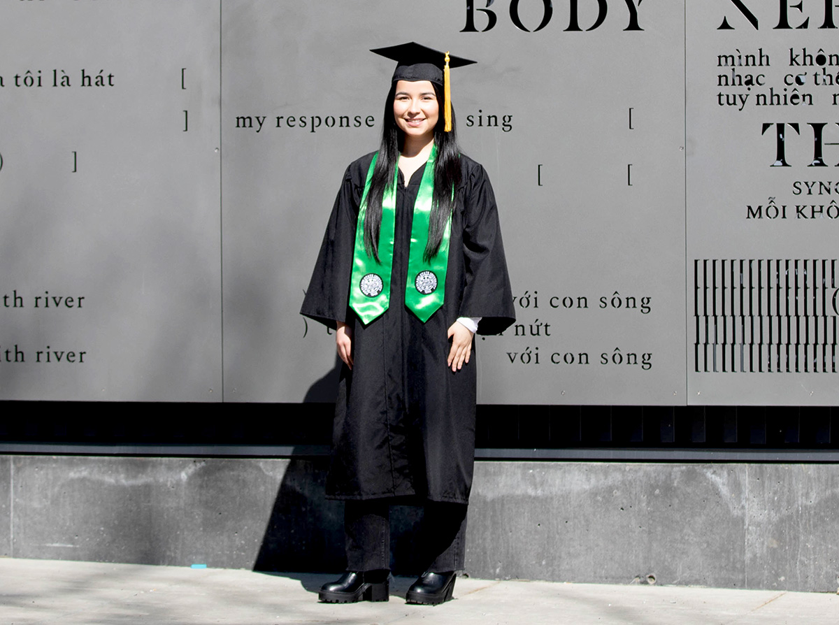 Portland State commencement gown is black, long sleeved and ends below knee to mid-calf.
